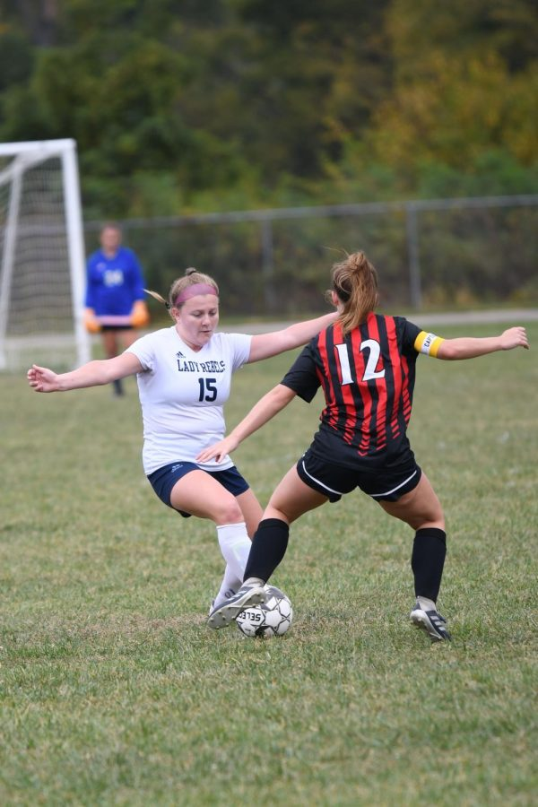 Senior Maddy Hobbs takes on an opponent during Boone County's 2-1 win over Holy Cross on Oct. 10 in Covington.