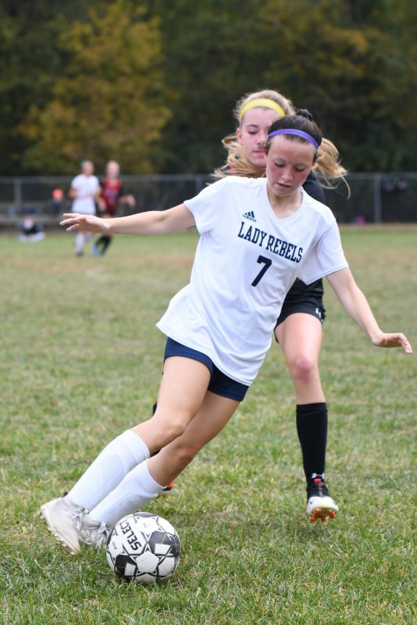 Sophomore Emily Hunley works to get around a defender during Boone County's 2-1 win over Holy Cross on Oct. 10 in Covington. Hunley scored a goal in the match.
