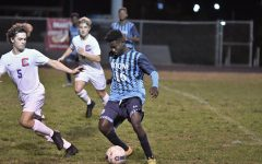 Senior Mardoche Matumueni dribbles the ball during Boone's home game vs Conner on Oct. 8.