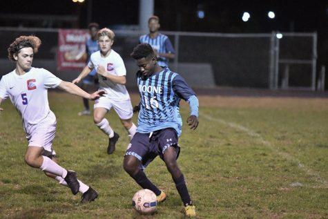 Senior Mardoche Matumueni dribbles the ball during Boone
