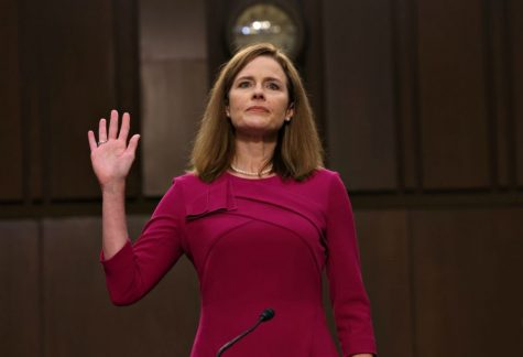 Amy Coney Barrett takes an oath during a Senate hearing on Oct. 27. Barret