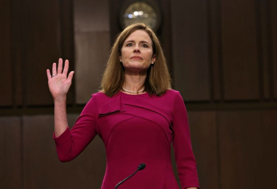 Amy Coney Barrett takes an oath during a Senate hearing on Oct. 27. Barret's confirmation to the Supreme Court makes her the closest to be nominated and confirmed prior to an election.