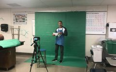 Principal Tim Schlotman is recorded in front of a green screen in room 227 for the Principal's Report video that was published on Nov. 20.