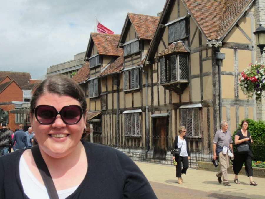 Teacher Megan Steffen takes photo in front of Shakespeare recreation house in Stratford-Upon-Avon, Warwickshire, England.