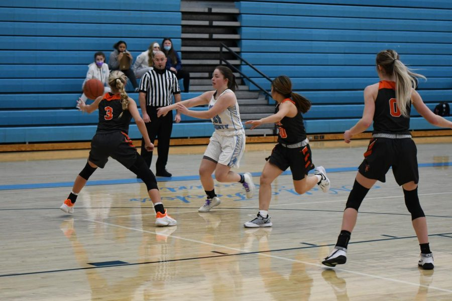 Senior Maddie Brown passes through the defense during the varsity basketball game against Ryle High School on Jan. 22.