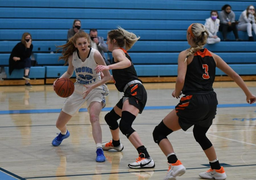 Senior Molly Benton drives along the baseline during the varsity basketball game against Ryle High School on Jan. 22.