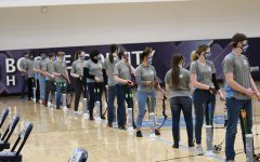 The Rebel Archers line up to shoot from 15 meters at the Boone archery tournament on Feb. 20.