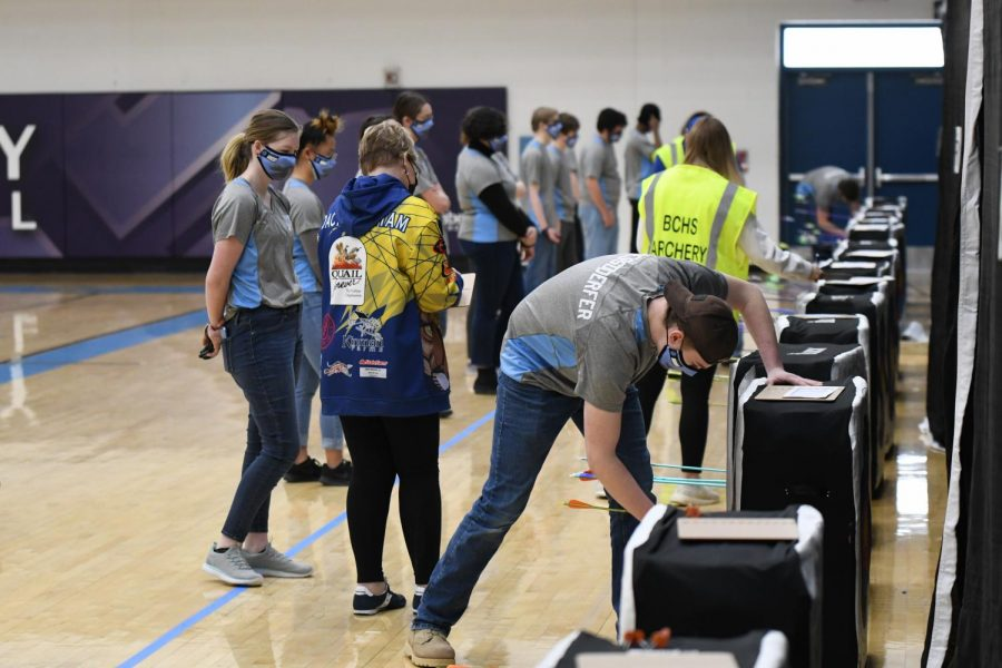 Sophomore Connor Hessdoerfer removes his arrows while the judges continue scoring targets at the Boone archery tournament on Feb. 20.