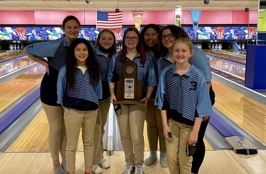 Members of the region runner-up girls bowling team pose with their trophy. From left to right: junior Brenna Kelley, 7th grader Araceli Acosta,  junior Savannah Pence, senior Hailee Williams, junior Lillianna Acosta, sophomore Cacey Gosney, and 7th grader Isabella Sears.
