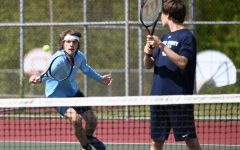 Senior Kendall Soules and freshman Landon Molhem play first doubles against Dixie Heights on May 11 at Boone Woods.