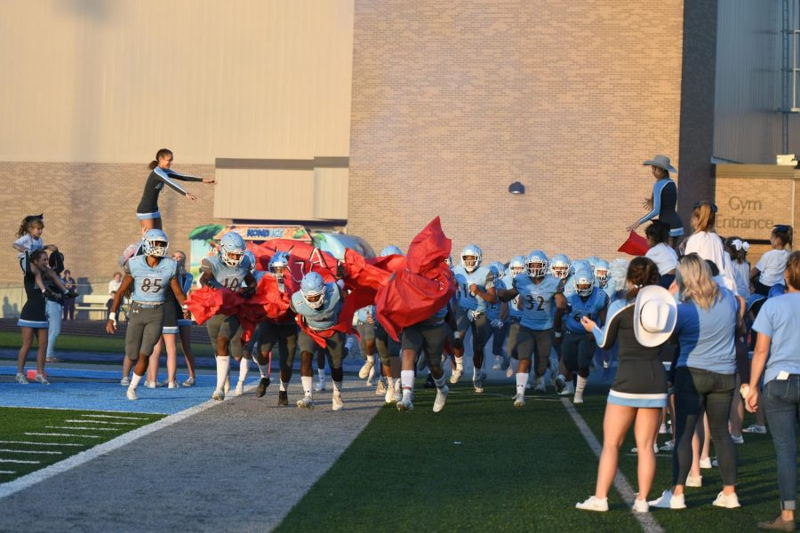 The Rebels make their entrance against Conner High School on Sept. 24.